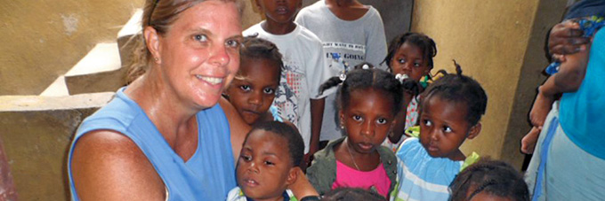 Jamie Schumacher with kids in Haiti